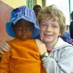 A young Swazi child with Luke VanderWal. By 2012, 20 percent of the Swazi population will be orphans under the age of 17.