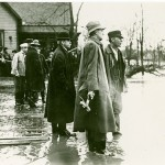 NCR owner John H. Patterson surveys the flood damage.