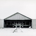 Wright Model B Flyer fitted with twin pontoons sitting in a hangar.
