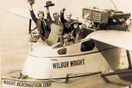 Percy Mackaye, Vilhjalmur Stefansson, and Orville and Katharine Wright wave from the Wright Aeronautical Corporation flying boat the Wilbur Wright at its christening in 1922.