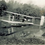 The Wright Model CH Flyer on the Miami River in the summer of 1913. The Flyer is fitted with a single large main pontoon and a smaller pontoon attached to the tail.