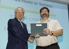 Photo of Ron Wukeson receiving his employee recognition award.