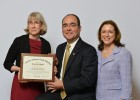 AAFP President Jeff Cain, M.D., presents the AAFP Top Ten Award to Amanda Bell, M.D., WSU associate professor of family medicine (left), and Dean Marjorie Bowman, M.D., M.P.A.