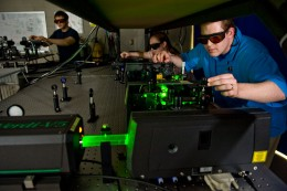 Students working with lasers in a Wright State physics lab.