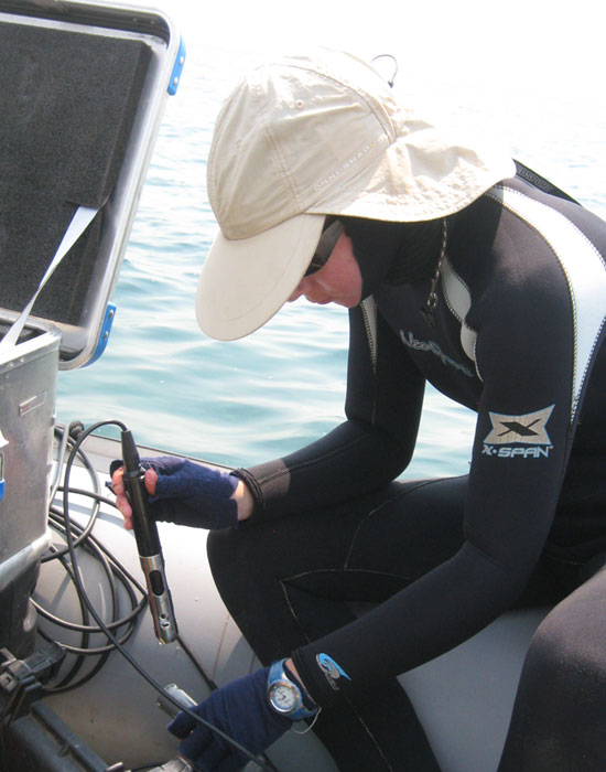 Wright State Ph.D. student Brianne Kelly taking oxygen measurements at Lake Tanganyika in east Africa.