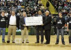 Photo of Reynolds and Reynolds check presentation at Valpo B-Ball game