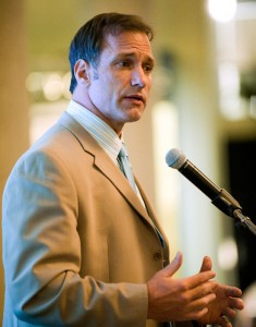 Close-up photo of Chris Spielman speaking at the podium.