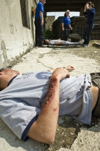 Photo of injured person in need of medical care during mass casualty exercise at Calamityville.