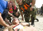 Photo of military and medical personel treating a hurt citizen during the mass casualty exercise.