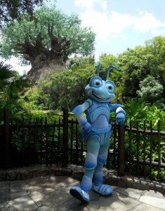 A Bug's Life movie character poses for a picture along a fence at Walt Disney World.