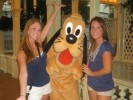 Tiffany Fridley poses with Pluto and another student intern at Walt Disney World.