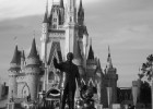 Picture of Walt Disney and Mickey Mouse statues in front of Cinderella's Castle at Disney World.