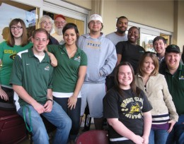 Photo of ten Wright State students at a Dayton Dragons game in the DP&amp;L Foundation suite.