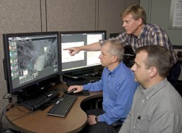 Photo of Dave Gross, Greg Feitshans, Mark Mears with Vigilant Spirit UAV ground station.