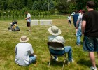 Photo of crowd watching students remotely drive robotic lawn mowers.