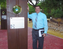 Photo of Dr. Cambronero next to one of the monoliths.
