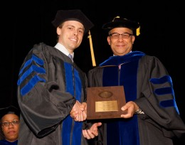 Photo of SOPP Dean Larry James presenting the Dean's Award to SOPP Graduate Brent Funk.