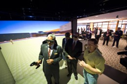 Photo of distinguished guests from the July 18 news conference touring the R.C. Appenzeller Visualization Laboratory at Wright State.