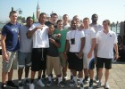 Photo of the Wright State men's basketball team posing for a picture befor boarding gondullas in Venice, Italy.
