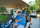 Photo of Rowdy Raider on a golf cart.