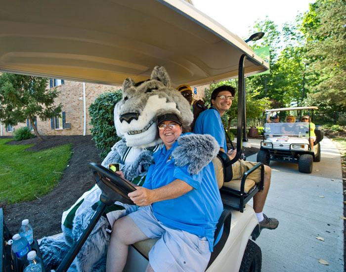 Photo of Rowdy Raider on a golf cart.