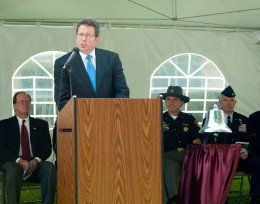 Photo of Jim Gruenberg at the podium.