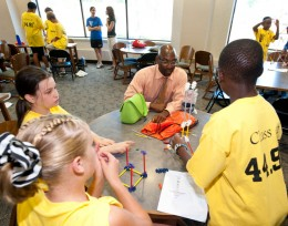 Photo of David Lawrence visiting with students.