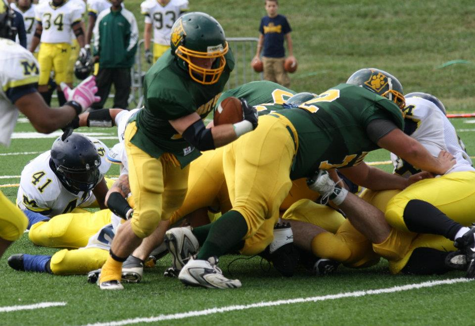 Photo of Trevor Luckenbill going in for the touchdown.