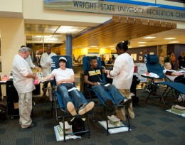 Photo of students giving blood at the Student Union.