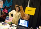Photo of a woman at the Malaysia table at the 2010 International Friendship Affair