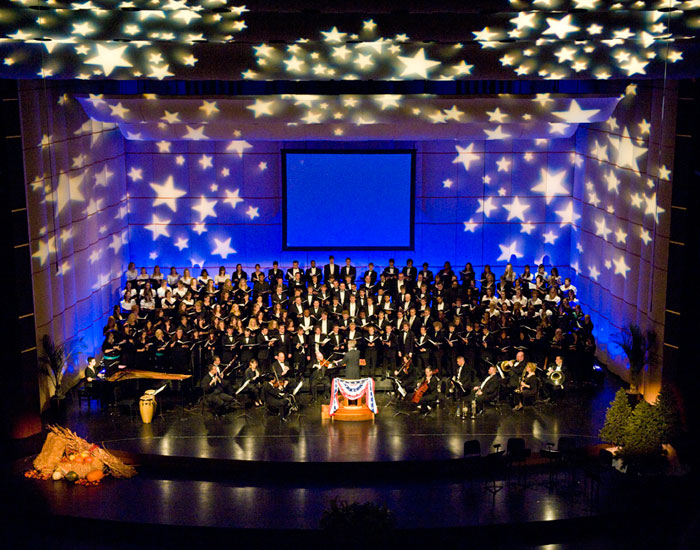 Photo of the orchestra and choir onstage at the Schuster Center.