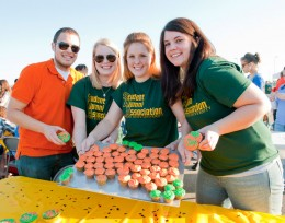 Photo of Dan Baker, Michelle Shreck and Kimberly Trame showing off their cupcakes during the Cupcake Wars contest at Raider Fest.
