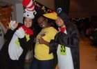 Photo of students dressed as the Cat in the Hat and as a penguin at the 2010 Multicultural Halloween.