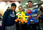 Photo of three students with balloon animals.