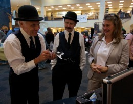 Tom Benson (left) and Roger Storm of the NASA Glenn Research Center in Cleveland, impersonating Wilbur and Orville Wright, examine micro air vehicles with Amanda Wright Lane during Wright Brothers Day in the Student Union Atrium. Wright Lane is the great-grandniece of the real Wright brothers.