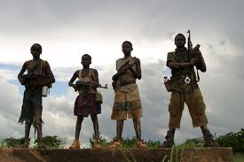 Photo of four child soldiers in Uganda.