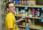 Photo of a student helping stock the Wright State Friendship Food Pantry