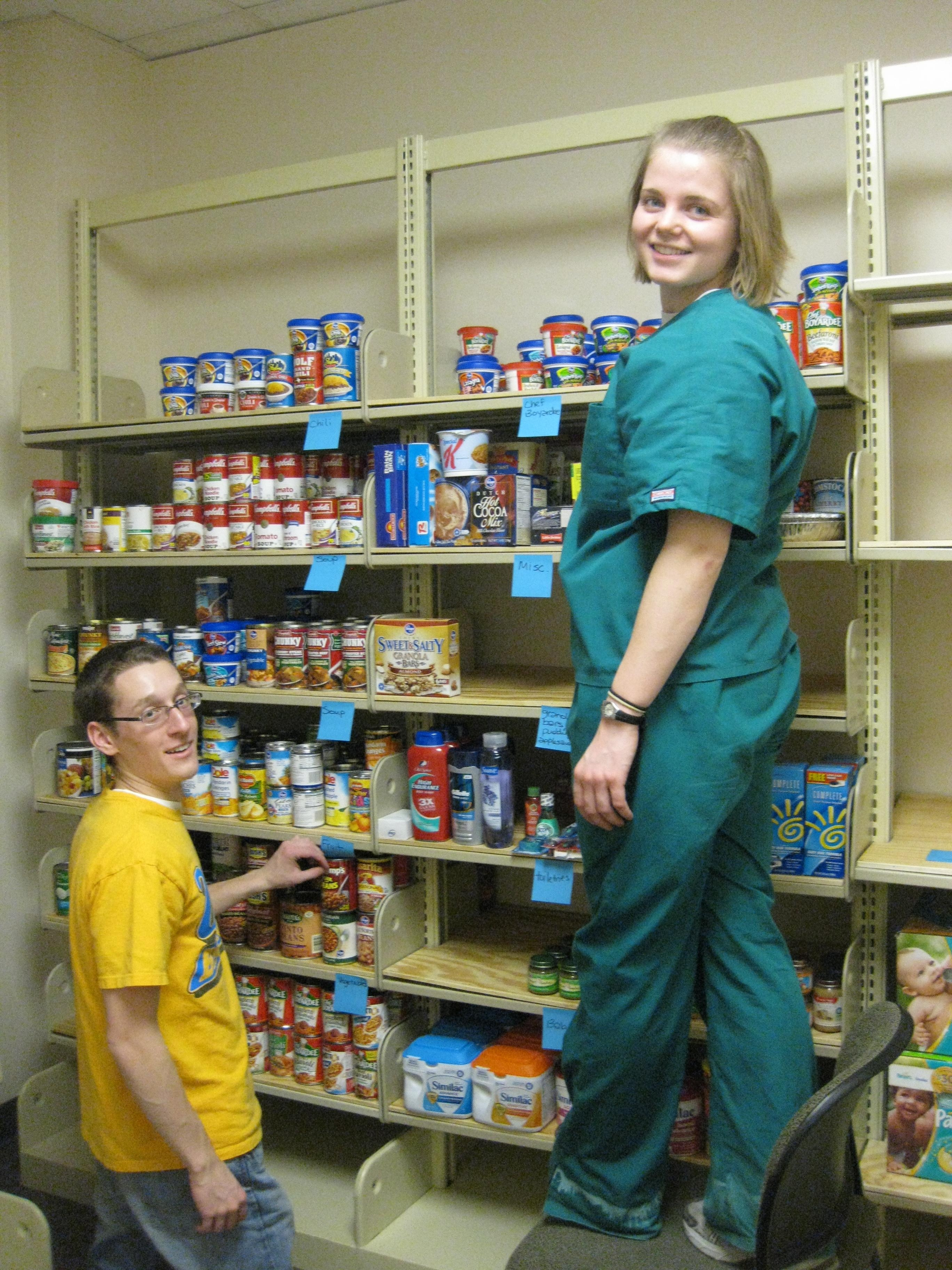 Wright State students help to stock the Friendship Food Pantry on campus.