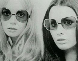 Photo of two women from the 1970s wearing sunglasses.