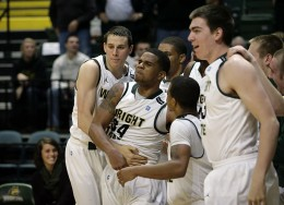 Photo of Julius Mays celebrating with teammates after hitting the game-winning shot.