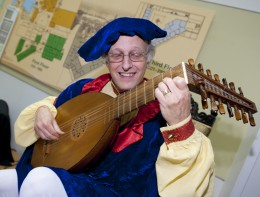 Photo of Jim McCutcheon playing the Lute.
