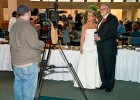 Photo of Ran and Mary Raider being interviewed at their wedding.
