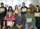 Photo of several of the contest winners and President David R. Hopkins as well as contest organizer Linda Ramey.