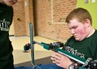 Photo of two students testing a robotic arm