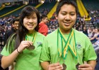 Photo of two students with medals