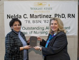 Photo of outstanding CoNH alumni Nelda Martinez and CoNH Dean Rosalie Mainous.
