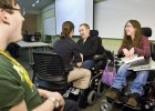 Photo of physicaly disabled Wright State students talking in a classroom.