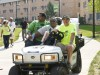 Photo of former Wright Stste employee Mike Schulze helping parents and students move on to campus during Move-in Day.