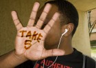 "Photo of hand with the words ""Take 5"" written on the palm"