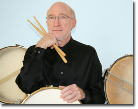 Photo of Bob Becker with Drums